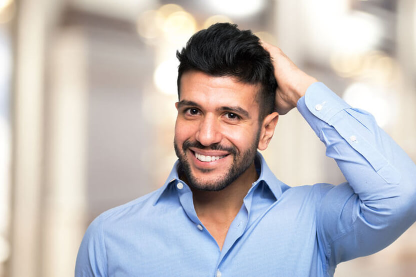 Portrait of a man touching his hair